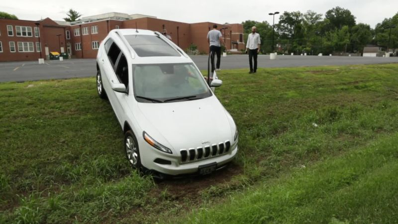 Car Drives Through Security Service