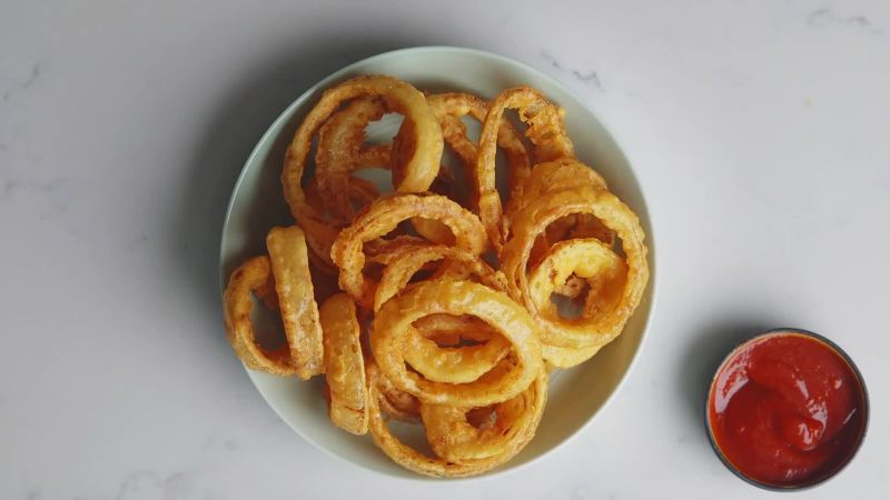 Watch The Secret to Crispy, Perfect Onion Rings | Epicurious Video | CNE