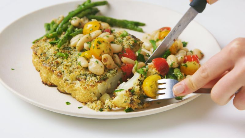 Watch Herb-Crusted Cauliflower Steaks with Beans and Tomatoes   Epicurious Video   CNE