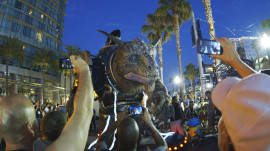 Watch the Giant Creature Crash Through San Diego Comic-Con 2014