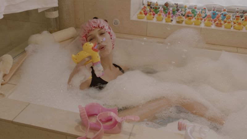Watch Bella Hadid, a Bubble Bath, and Jenga: What More Could You ...