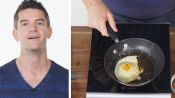 50 People Try to Make an Over Easy Egg