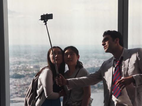 The Selfie-Stick Photographer