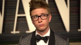 Watch Tyler Oakley Try to Flag Down Leonardo DiCaprio and Lady Gaga on the Oscar Party Red Carpet