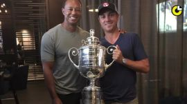 Justin Thomas celebrates his PGA win with Tiger Woods