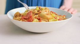 Antipasto Pasta with Sausage, Artichoke Hearts, and Sun-Dried Tomatoes
