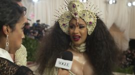 Cardi B on Her Kicking Baby and Pearl-Covered Dress
