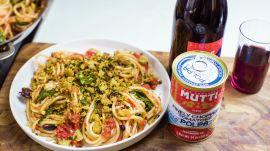 Spaghetti with Tomatoes, Arugula, Olives, and Pangrattato